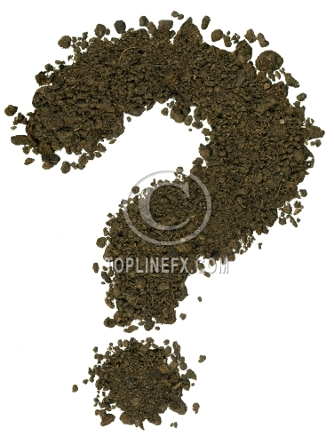 Alphabet made of brown soil on white background. Question mark