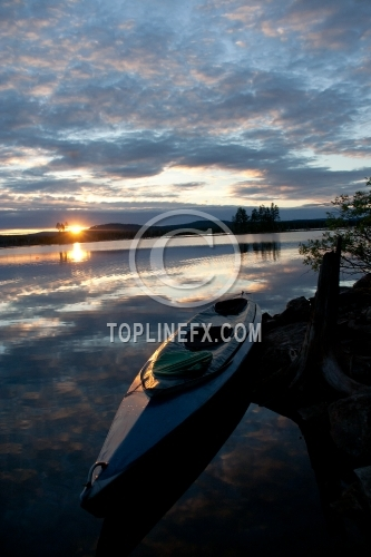 Canoe on Lake in North Europe02