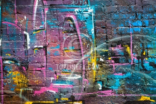 Grunge brick wall with gaffiti and colorful  paint